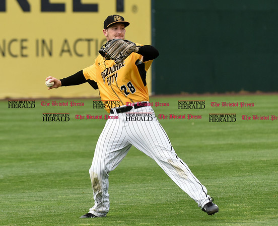 052617 Wesley Bunnell | Staff The New Britain Bees were defeated by the Southern Maryland Blue Crabs 3-1 on Friday evening. Conor Bierfeldt (28) fields a single to left field and prepares to throw.