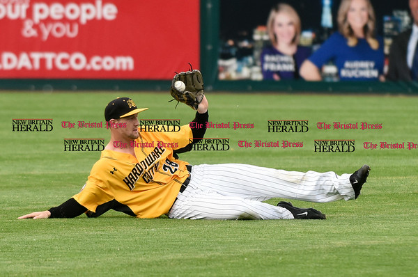 052617 Wesley Bunnell | Staff The New Britain Bees were defeated by the Southern Maryland Blue Crabs 3-1 on Friday evening. Left fielder Conor Bierfeldt (28) with a sliding catch in the first inning.