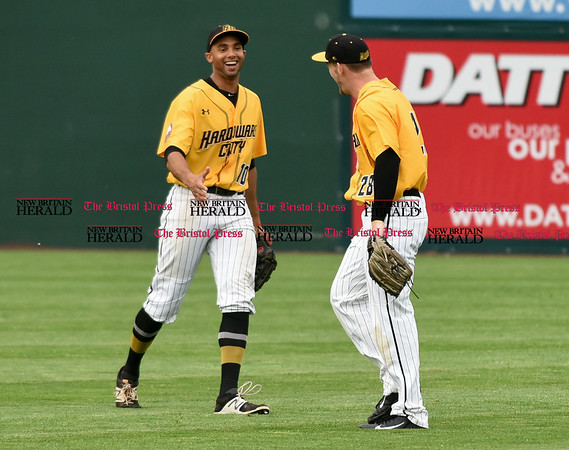 052617 Wesley Bunnell | Staff The New Britain Bees were defeated by the Southern Maryland Blue Crabs 3-1 on Friday evening. Conor Bierfeldt (28) laughs along with Mike Crouse (10) after making a sliding catch in left field.