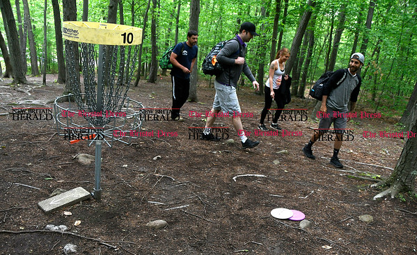 5/27/2017 Mike Orazzi | Staff Mike Cronin, Mike Berggren,Allie Maynard and Joe Richardson while playing a disk golf fundraiser for Kevin Adorno in Page Park Saturday morning.