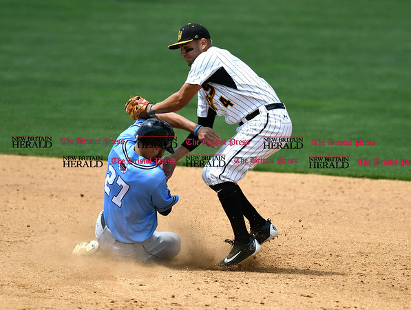 5/27/2017 Mike Orazzi | Staff New Britain Bees' Steve Carrillo (4) and the Southern Maryland Blue Crabs' Cory Vaughn (27) Saturday at New Britain Stadium.