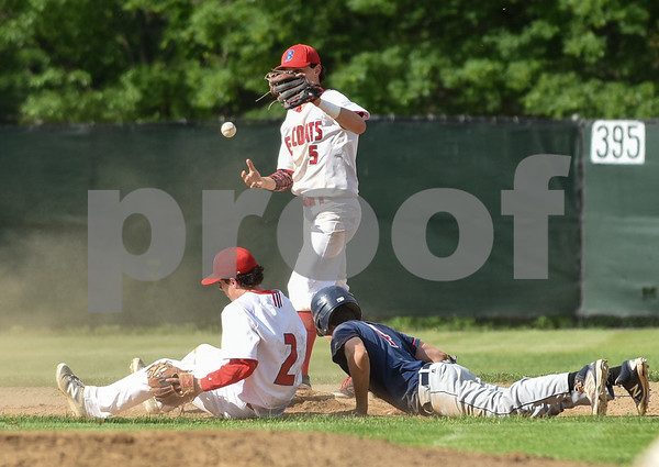 053117 Wesley Bunnell | Staff Berlin High baseball eliminated in the second round of the Class L state tournament by Foran High from Milford. Nicholas Carroll (2) is unable to tag the Foran runner in time and tosses the ball to Cody Lacasse (5).