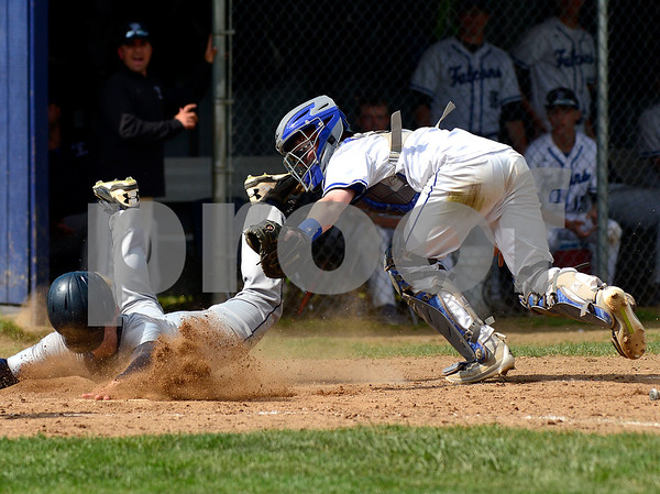5/31/2017 Mike Orazzi | Staff St. Paul's Christopher Mills (16) tags out Immaculate's Zachary Demko (9) during the Class S Second Round Baseball game with Immaculate in Bristol Wednesday.