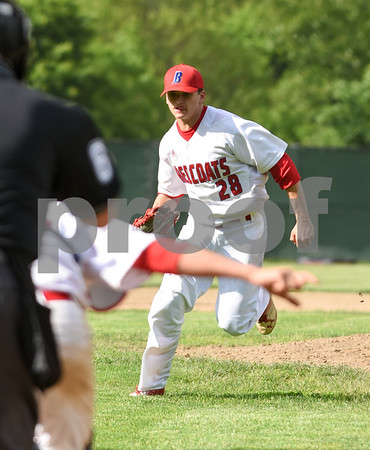 053117 Wesley Bunnell | Staff Berlin High baseball eliminated in the second round of the Class L state tournament by Foran High from Milford. Pitcher Zachary Philippon (28) fields a soft ground ball in front of the mound.