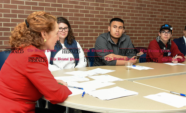 050517 Wesley Bunnell | Staff Congresswoman Elizabeth Esty spoke with CCSU student leaders on an Immigration Roundtable on Friday afternoon. Congresswoman Esty, student Victor Constanza, middle & Akai Long.