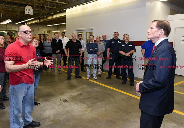050517 Wesley Bunnell | Staff A workers asks questions of Senator Richard Blumenthal during his visit to Winslow Automatics Incorporated on Friday afternoon for a discussion on small businesses. Winslow manufacturers parts for use on the engine of the F-35 fighter.