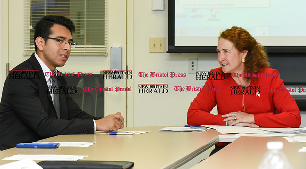 050517 Wesley Bunnell | Staff Congresswoman Elizabeth Esty spoke with CCSU student leaders on an Immigration Roundtable on Friday afternoon. Student Jose Diaz addresses the table with Congresswoman Elizabeth Esty.