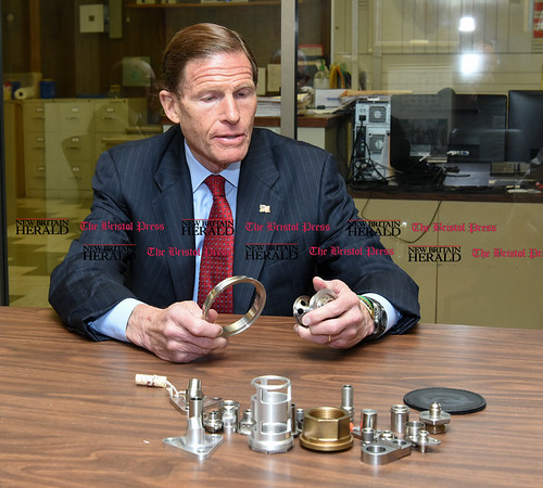 050517 Wesley Bunnell | Staff Senator Richard Blumenthal holds parts manufactured by Winslow Automatics Incorporated for the engine of the F-35 fighter. The senator visited Winslow Automatics Incorporated on Friday afternoon for a discussion on small businesses.