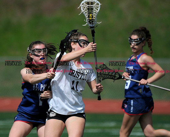 5/6/2017 Mike Orazzi | Staff Bristol Coop Girls Lacrosse Ashley Macdonald (11)during lacrosse with St. Paul Catholic High School's Emma Cretella (1) Saturday at Bristol Eastern.