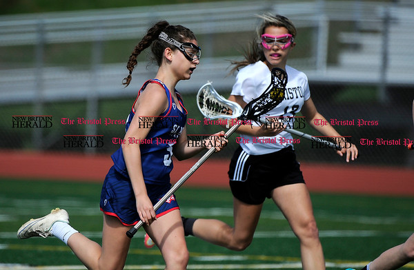 5/6/2017 Mike Orazzi | Staff Bristol Coop Girls Lacrosse Nataly Domitrz (13) during lacrosse with St. Paul Catholic High School's Carolyn Del Debbio (5) Saturday at Bristol Eastern.