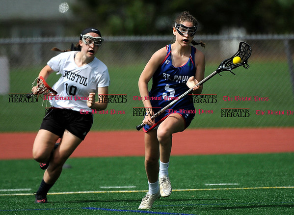 5/6/2017 Mike Orazzi | Staff Bristol Coop Girls Lacrosse Emily Stadnicki (10) and St. Paul Catholic High School's Carolyn Del Debbio (5) Saturday at Bristol Eastern.