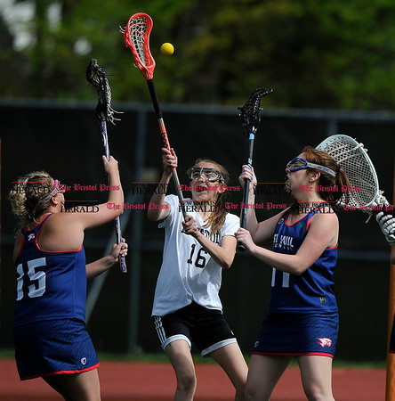 5/6/2017 Mike Orazzi | Staff St. Paul Catholic High School's Morgan Middleton (15) and Anne Sullivan (11) with Bristol Coop's Allison Jessie (16) Saturday at Bristol Eastern.