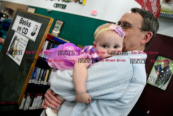 5/6/2017 Mike Orazzi | Staff Link Hullar holds his grand daughter Claire McCarthy during the Southington Public Library's ComicCon Saturday.