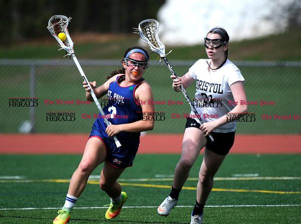5/6/2017 Mike Orazzi | Staff St. Paul Catholic High School's Catherine Ciampi (2) and Bristol Coop's Jade Longo (31) Saturday at Bristol Eastern.