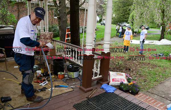 5/6/2017 Mike Orazzi | Staff Paul Mallia works on electrical outlets during Saturday's HomeFront Day on Grove Hill Street in Berlin.