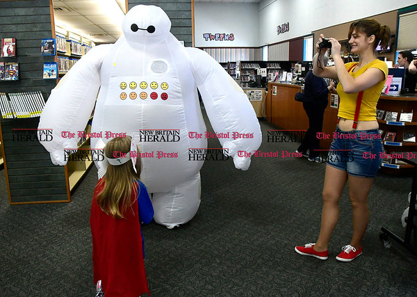 5/6/2017 Mike Orazzi | Staff Anne Ditieri photographs Elise Hayden as she greets Bernie Berube during the Southington Public Librarys ComicCon Saturday.