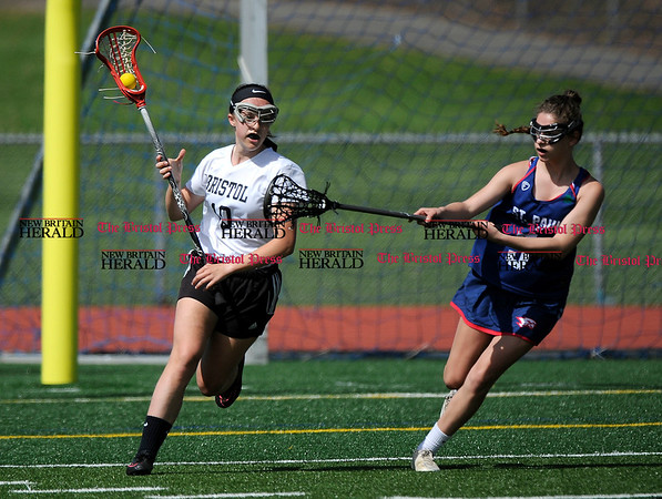 5/6/2017 Mike Orazzi | Staff Bristol Coop Girls Lacrosse Emily Stadnicki (10) during lacrosse with St. Paul Catholic High School's Carolyn Del Debbio (5) Saturday at Bristol Eastern.