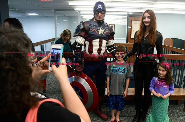 5/6/2017 Mike Orazzi | Staff Gabe and Amelia Reinhart pose with Steve Rychlec and his daughter Alana during the Southington Public Library's ComicCon Saturday.