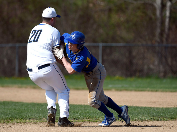 5/1/2018 Mike Orazzi | Staff St. Paul's Ryan Greene (20) and Seymour's John Chacho (4) on a pickoff Tuesday in Bristol.
