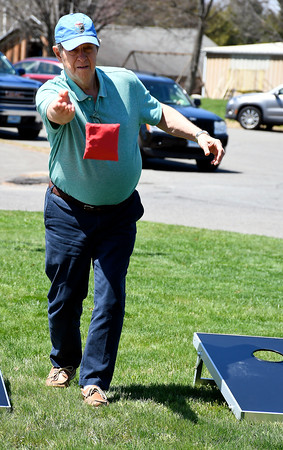 5/1/2018 MIke Orazzi | Staff Jack O'Dell while tossing bean bags during the senior olympics at the Bristol Senior Center Tuesday.
