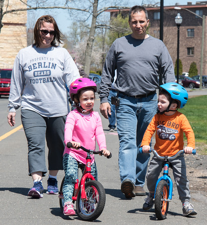 05/01/18 Wesley Bunnell | Staff Amie and Nicholas Eliades follow their twins Emma and George, age 3, as they ride their bikes around Walnut Hill Park on a warm Tuesday afternoon.