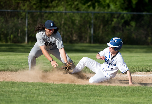 05/14/18 Wesley Bunnell | Staff St. Paul Catholic baseball vs Oxford at St. Paul Catholic High School on Monday afternoon. David Strager (3) slides safely into third.