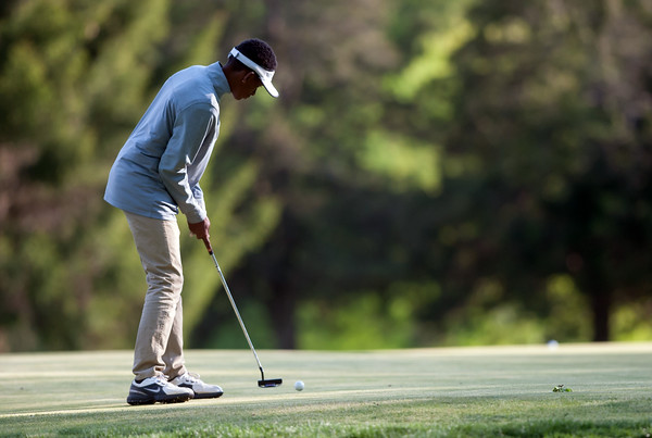 05/10/18 Wesley Bunnell | Staff New Britain golf defeated Bristol Eastern 212-219 at Stanley Golf Course on Thursday afternoon. New Britain's Dylan Washington putts on the 9th hole.