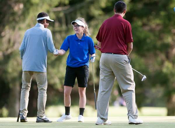05/10/18 Wesley Bunnell | Staff New Britain golf defeated Bristol Eastern 212-219 at Stanley Golf Course on Thursday afternoon. New Britain's Dylan Washington, L, shakes hands with Bristol Eastern's Olivia Beaudoin at the conclusion of the match.
