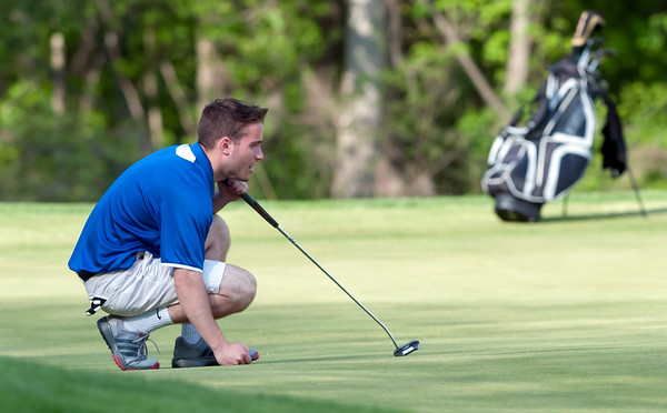 05/10/18 Wesley Bunnell | Staff New Britain golf defeated Bristol Eastern 212-219 at Stanley Golf Course on Thursday afternoon. Bristol Eatern's Brendan McMahon lines up a long putt.