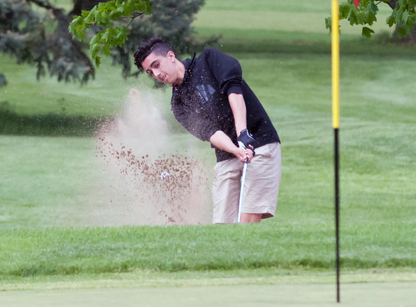 05/10/18 Wesley Bunnell | Staff New Britain golf defeated Bristol Eastern 212-219 at Stanley Golf Course on Thursday afternoon. New Britain's Johnny Morell hits out of the bunker.