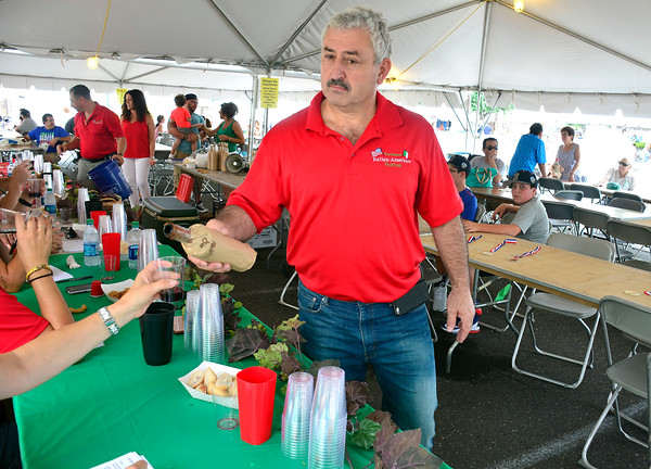 7/30/2016 Mike Orazzi | Staff Carmine Mennone pours wine during the wine contest at the 12th annual Italian American Festival on lower Center Street in downtown Southington Saturday afternoon.