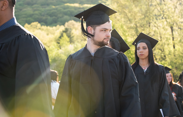 05/11/18 Wesley Bunnell | Staff Lincoln College of New England held their Fifty-first Annual Commencement Ceremony on Friday evening on the college campus. Students look over their shoulders at family and friends as they march to their seats.