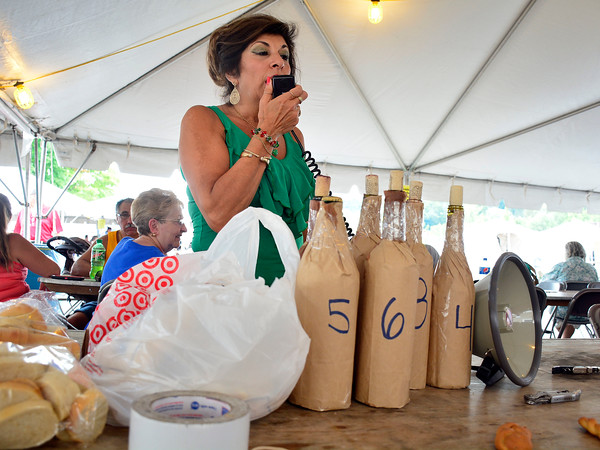 7/30/2016 Mike Orazzi | Staff Antonietta Barbato describes the different wines during the wine contest at the 12th annual Italian American Festival on lower Center Street in downtown Southington Saturday afternoon.