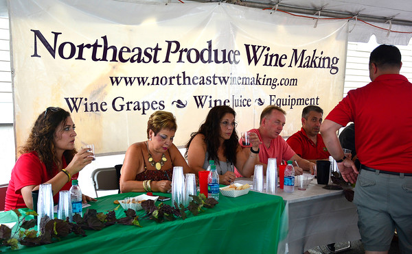 7/30/2016 Mike Orazzi | Staff Judges during the wine contest at the 12th annual Italian American Festival on lower Center Street in downtown Southington Saturday afternoon.