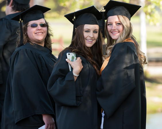 05/11/18 Wesley Bunnell | Staff Lincoln College of New England held their Fifty-first Annual Commencement Ceremony on Friday evening on the college campus. April Wisneski, Lorauren Harris and Hayley Baker smile as they wait in line for commencement.