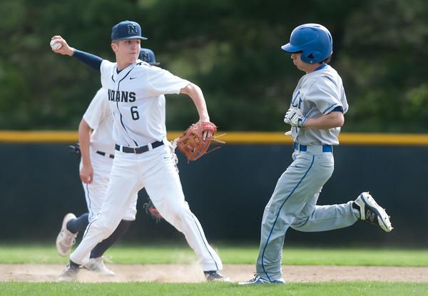 05/11/18 Wesley Bunnell | Staff Newington baseball vs Hall on Friday afternoon at Newington High School. Mike Sobolewski (6) turns the double play.