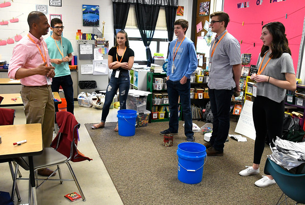 5/11/2018 Mike Orazzi | Staff Bristol Eastern High School chemistry teacher Orlando Valle talks with student volunteers during a Science, Technology, Engineering, Art, Math held Friday morning.