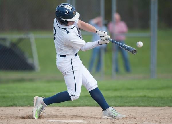 05/11/18 Wesley Bunnell | Staff Newington baseball vs Hall on Friday afternoon at Newington High School. Cooper Johnson (3) makes contact for a base hit.