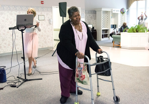 05/15/18 Wesley Bunnell | Staff Singer Kate Stone entertained the residents of Autumn Lake Healthcare in New Britain during Happy Hour on Wednesday May 15th. Resident Harriet Taylor dances in front of the crowd.