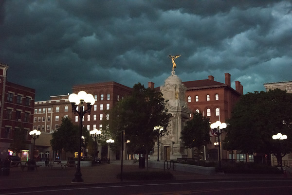 05/15/18 Wesley Bunnell | Staff Storm clouds roll over New Britain City Hall and the monuments in Central Park at 5:00pm Tuesday on which just a short time before was a bright sunny day.
