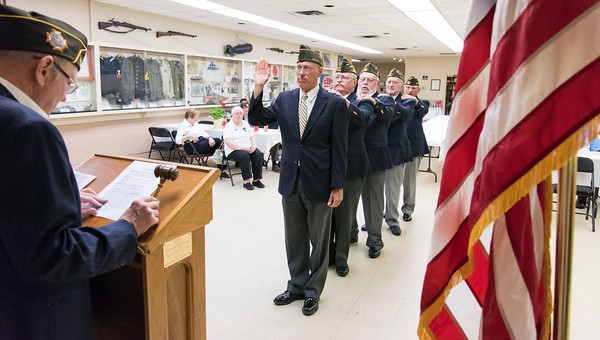 05/16/18 Wesley Bunnell | Staff The Berlin VFW 10732 held their installation of officers on Wednesday May 16th. Senior Vice Commander Bill Hamel stands in for the incoming Commander who was unable to attend as Chaplain Ron Levandowsky stands behind him with his hand on his shoulder and Dave Klowskowski reads the oath.