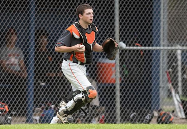 05/16/18 Wesley Bunnell   Staff Newington baseball defeated E.C. Goodwin Tech on Wednesday afternoon at Newington High School. Goodwin Tech catcher Matt Anderson (9) after tracking down a pop up near his team's bench.