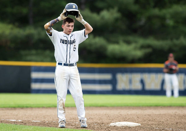 05/16/18 Wesley Bunnell | Staff Newington baseball defeated E.C. Goodwin Tech on Wednesday afternoon at Newington High School. Gunnar Johnson (5) adjusts his helmet on third base.