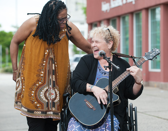 05/17/18 Wesley Bunnell   Staff The New Britain Artists' Co-op held open mic outdoors on Thursday night at KC's on Main. Artist Leslie Manselle sings along with Jill Free to start off the event.