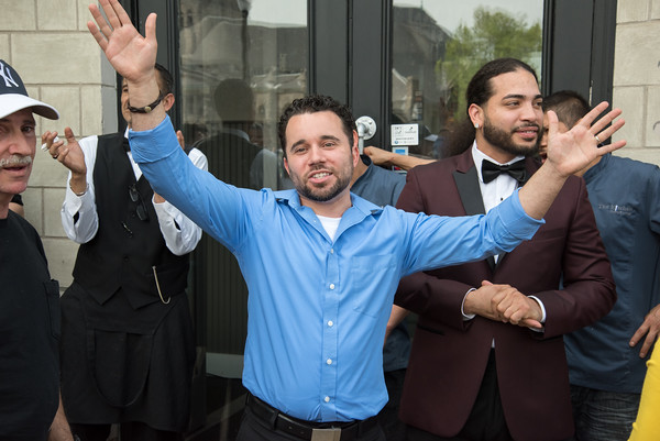 05/17/18 Wesley Bunnell   Staff Vincent Placeres held a ribbon cutting for his newest restaurant The Kitchen on Thursday afternoon down the street from Mofongo Restaurant which he opened in 2017. Placeres holds out his hands as he speaks to the crowd and invites them into the restaurant.