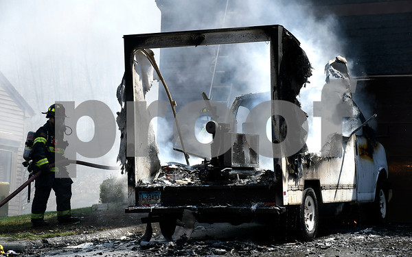 5/2/2018 Mike Orazzi | Staff Bristol firefighters extinguish a truck fire with extension to an adjacent building at the Southridge Condominiums in Bristol Wednesday.