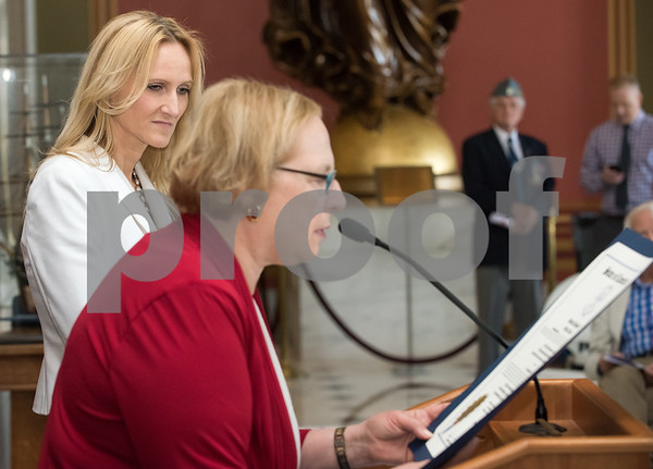 05/02/18 Wesley Bunnell | Staff Polish Day at the Capitol was held on Wednesday morning int he State Capitol to commemorate the 227th anniversary of the Polish Constitution and the 27th anniversary of the event. 2018 Honoree Asha Lassen, R, looks on as State Senator Terry Gerratana reads her citation.