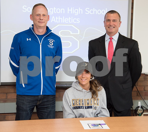 05/02/18 Wesley Bunnell | Staff Southington student athlete Taylor Hubert poses for a photo with assistant soccer coach Walt Swanson, L, and head coach Mike Linehan after signing her letter of intent to attend and play soccer for Div. II Merrimack College.