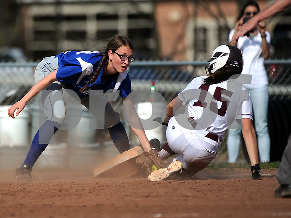 5/2/2018 Mike Orazzi | Staff Bristol Eastern's Jenna Winters (16) and Bristol Central's Gewn Torreso (15) during Wednesday's softball with Bristol Central at BE.