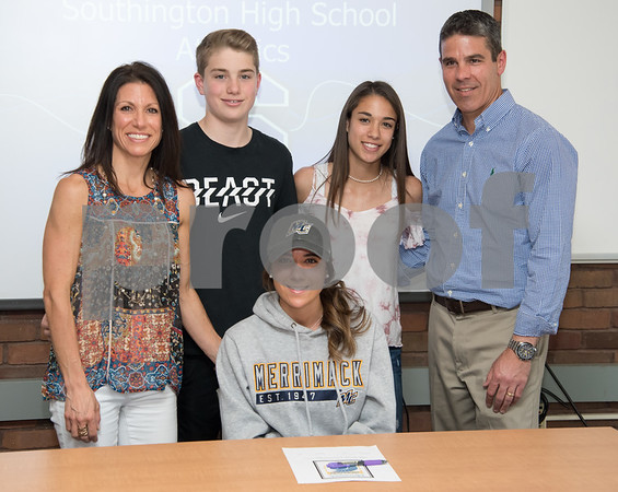 05/02/18 Wesley Bunnell | Staff Southington student athlete Taylor Hubert, front center, is surrounded by her family after signing her letter of intent to attend and play soccer for Div. II Merrimack College. Mother Tracy Hubert, L, brother Kevin, sister Morgan and father Kevin.